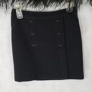 WHBM black knit mini skirt with faux buttons